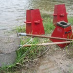 Tools for underwater viewing and baskets for scraping the riverbed. (Photo by Brian Robin)