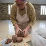 Kate preparing the clay. (Photo By Brian Robin)