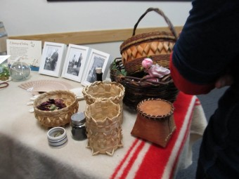 Some of Jenna's baskets and historical photos. (Photo by John Dickson)