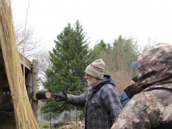 Bill Moses and his bee habitat, made from phragmites (photo by John Dickson)